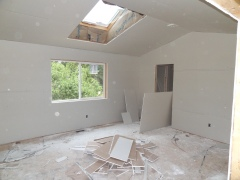 It's strange how getting the sheetrock up creates the illusion of a much smaller space