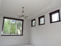 Dining room with lights and window trim in place