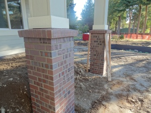 Brick supports underneath front porch posts