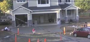 A preschooler leaves her mark in fresh concrete.